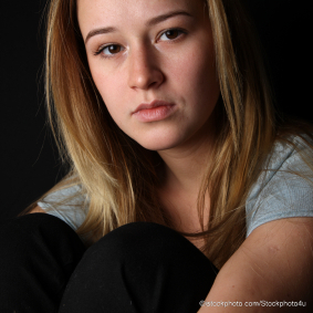 istock_stockphoto4u-1-teen-girl-hugging-knees-looking-sad-c